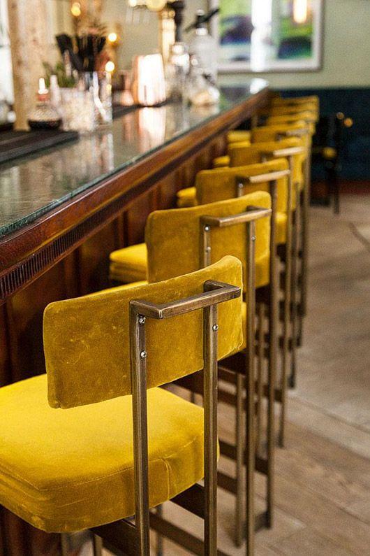 gold bar stools at maison lautrec in paris. / sfgirlbybay