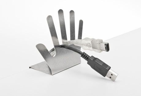 Organize cords with the Cable Butler, a cute hand-shaped cord organizer that clamps to your Moll desk.
