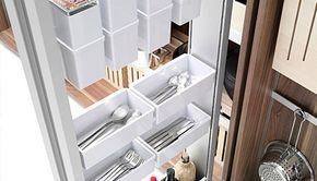 """This is different! ... dual """"tool cabinets,"""" which are designed to hold an array of """"appliances, crockery, tools and ingredients....[this is a] kitchen for pioneers in the art of thinking and living."""""""