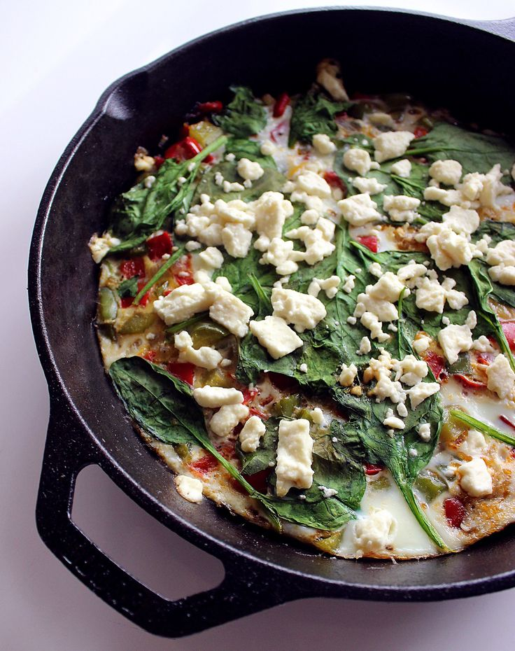 Egg White Frittata  INGREDIENTS 2 tablespoons olive oil 1 red pepper, chopped 1 green pepper, chopped 1/4 yellow onion, chopped 8 egg whites 1/2 cup feta cheese, crumbled 2 cups fresh spinach salt & pepper