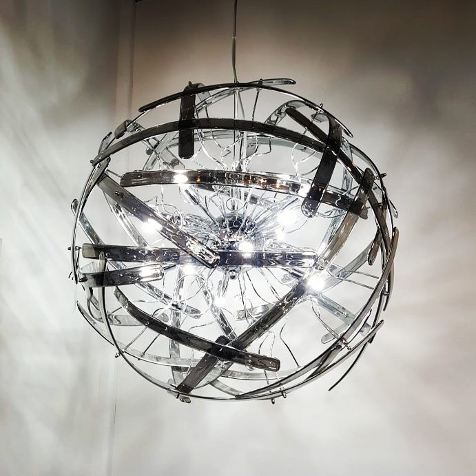 This Spectacular 12 Light Pendant with Smoked glass strips Interwoven around a polished Chrome frame to form a striking spherical Pendant.   This Modern Globe Pendant will hang as a striking statement piece in your home