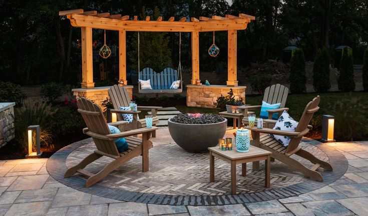 Casual Adirondack-style seating by hayneedle.com, including a bench swing hung f…