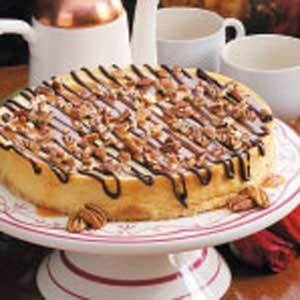 Chocolate-Caramel Topped Cheesecake Recipe -We serve this dessert at our house on special occasions. The topping on the cheesecake tastes like turtle candy.