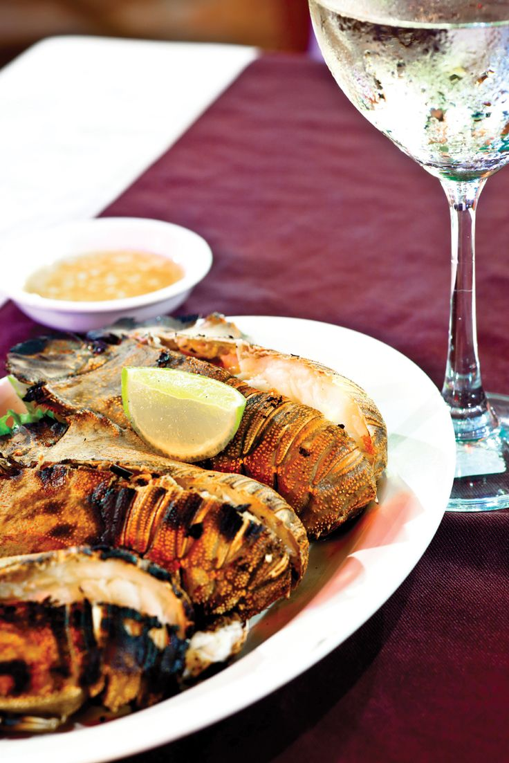 Spiny Lobster grilled on an open fire is a long time tradition in the Caribbean. Adding soaked fruitwood to a wood or coal grill will help to infuse the lobster meat with additional flavor.