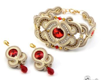 Set of bracelet and earrings,Soutache set,Elegant set,Glamour set,Soutache glamour,Soutache bracelet,Soutache earrings,Swarovski earrings --------------------------------------------------------------------------------------------------- Jewelery set in the technique of soutache embroidery made with: * satin soutache braids * glass crystals rivoli * high quality glass beads * high quality fire-polished beads, * TOHO seed beads * hypoallergenic earring posts Earrings: Total length: 4cm ...