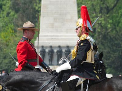 """A Royal Canadian Mounted Police officer and his Household Cavalry counterpart pass on Horse Guards Parade duties London 24 May 12 Re-enacting a gesture made by her father, King George VI, in 1936 the Queen celebrated the Commonwealth by inviting the RCMP to take part in British ceremonial. A relationship between the Royal Family and the Mounties was forged in 1904, when The Queen's grandfather, King Edward VII, granted the Canadian Mounted Police the precursor """"Royal"""" in recognition of…"""