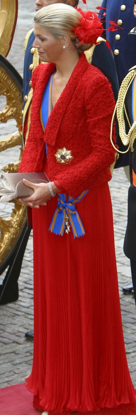 Princess Maxima wearing a red feathered fascination in 2002 to Prinsjesdag for the opening of Dutch Parliament.