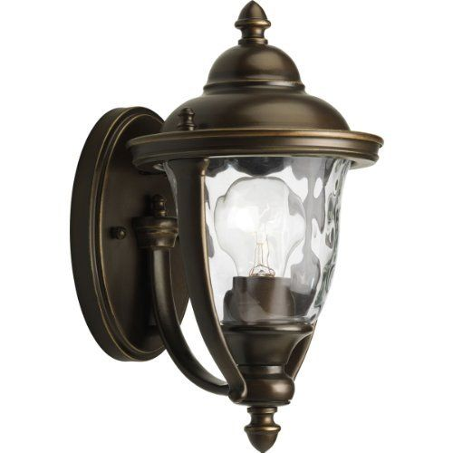 Progress Lighting P5920-108 1-Light Small Wall Lantern with Unique Cast Yoke Straps and Water Glass Urn Shades, Oil Rubbed Bronze by Progress Lighting. $59.97. From the Manufacturer                Stately without being stodgy, the Prestwick Collection is finely crafted from durable aluminum for years of reliable service. The yoke design cradles an urn-shaped water glass shade for sparkling illumination. A rich hand painted finish provides an artistic touch that will add a touch...