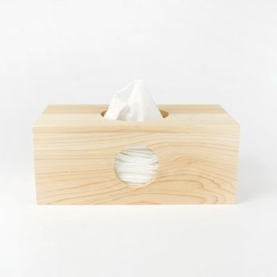 Native to Japan, Hinoki cypress wood is valued for its pleasing, fresh scent and anti-bacterial properties. Used to construct this tissue box, the wood creates a welcome alternative to paper tissue boxes with questionable graphic treatments. The wood used for the box is responsibly harvested from the thinning of managed natural forests.