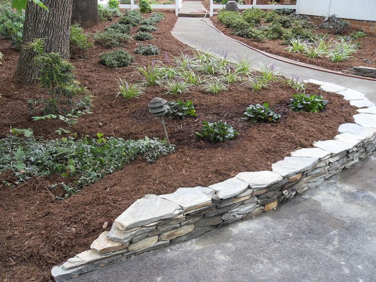 Flagstone retaining wall ideas custom stonework amp for Landscaping rocks greensboro nc