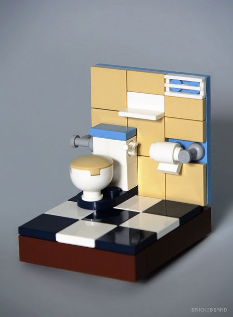 "I wanted to create a little toilet vignette with a minifig but when I put the minifig on it looked a bit out of scale, so I opted for a simple toilet scene. Since the beginning I wanted to use tiles as the wall instead of bricks, if you are wondering, yes, the wall is attached to the base with a 2x1 multi-sided brick :)   Also, thanks to ""d-higdon"" for the fantastic and inspiring work.  NOTE: I too hate toilet paper mounted underhand, but it was the only way here :D"