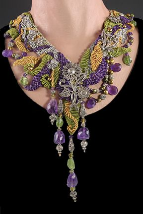 Scarf style necklace with antique marcasite phoenixes & flowers with matching beads and beads of silver, peridot, green pearl & amethyst. ~Barbara Natoli Witt