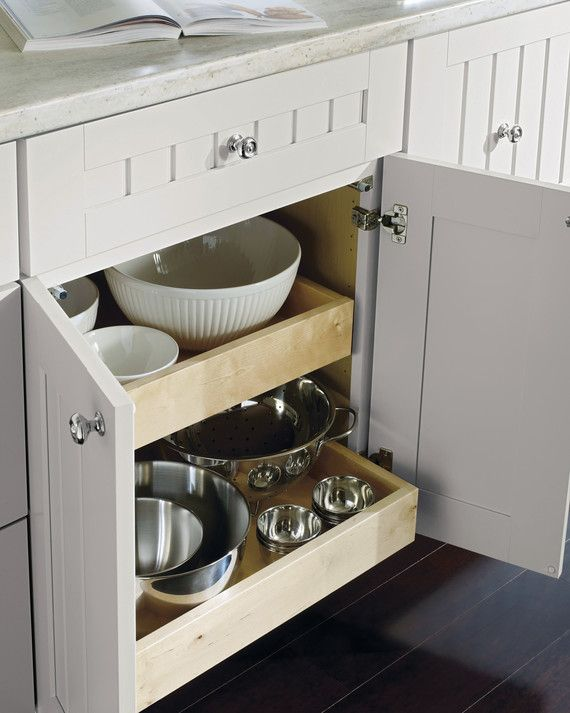 Organize your kitchen drawers according to gadget and tool type. Keeping all of your baking items in one location and your mixing bowls and collanders in another will create a more efficient kitchen space in no time. These drawers also offer roll-out shelves that will make your recipe roundup a breeze.