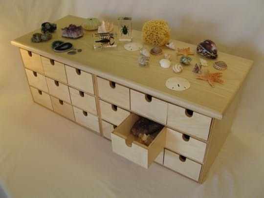 We've been enjoying the smallish nature corner in our home, inspired by this great idea. The collection is growing, however, with some pretty spectacular finds that we'd like to keep to bring out this time next year. If you've got the space for it, consider something like this Discovery Box.