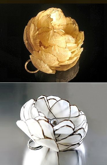 Inni Pärnänen (Finnish) botanical jewelry with a geometric bent -- flower ring in burnt paper & wax