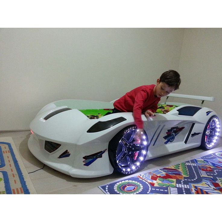 a white jaguar with led lights racecar bed for kids