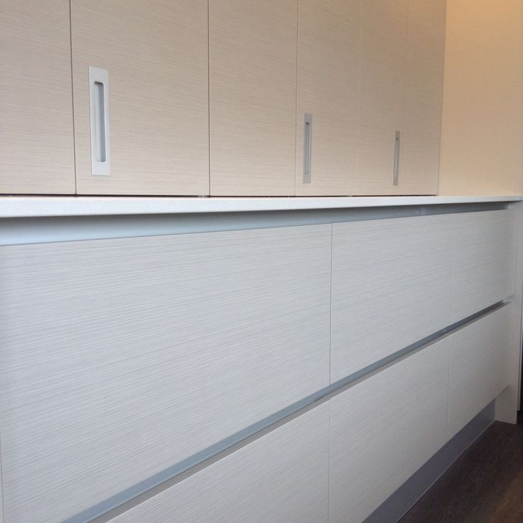"Sleek kitchen cabinetry in Prime Panel ""Stitch""."