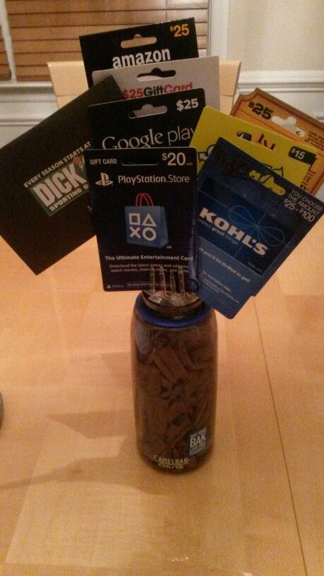 """Graduation gift 4 a guy....this one is for a teenager graduating frm 8th grade....thus 8 gift cards.   The """"water"""" n the vase is gum....lots of gum!!"""