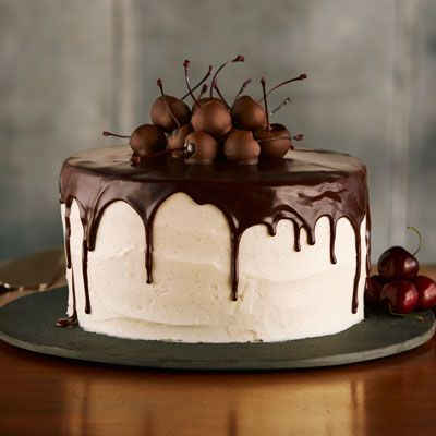 Decadent brownie layers, tart cherry jam and butter cream frosting topped with chocolate cherries create an extraordinary dessert perfect for a celebration.