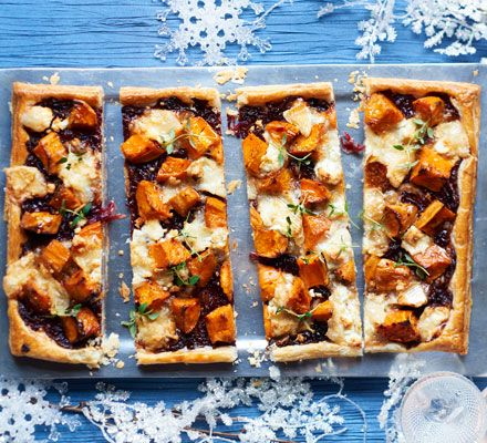 Top buttery puff pastry with caramelised onions and melted cheese for a festive buffet or dinner party winner that you can make ahead and freeze