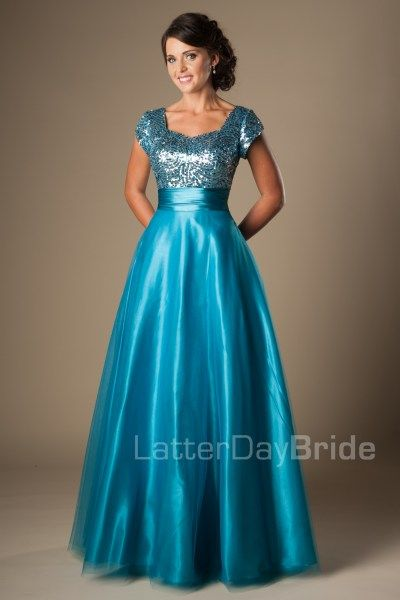 Jameson | Modest Prom Dress | Mormon Prom Gown | Sleeves | LatterDayBride & Prom | SLC | Utah | Worldwide Shipping | Sweethearts Ball Gown | Senior Dinner Dance Dress | In this chic and vibrant modest prom dress, you will certainly turn some heads.  The bodice features a sweetheart neckline, and a blingy sequined pattern with a wide waistband at the natural waist and a gentle shimmery A-line skirt.    Dress available in Capri