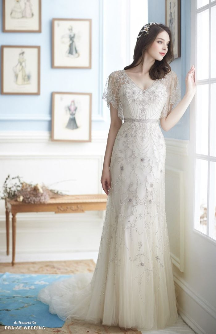 This Vintage Inspired Wedding Gown From Jessica Lauren Featuring Delicate Jewel Embellishments Is Beyond Incredible Vintage Inspired Wedding Gown Wedding Dresses Modern Wedding Dress