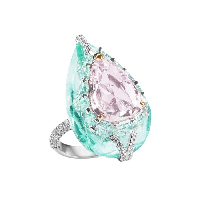 Boghossian Kissing Diamonds purpleish pink diamond and green beryl high jewellery ring. http://www.thejewelleryeditor.com/jewellery/article/boghossians-daring-creations-are-perfect-reason-visit-masterpiece/ #jewelry