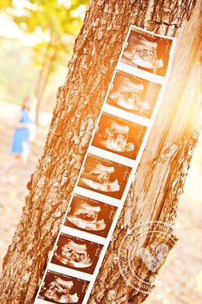 It would be cute to tape together a progression of ultrasound pictures and have a photo of baby at the bottom!