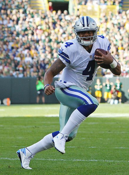 Dak Prescott Photos Photos - Dak Prescott #4 of the Dallas Cowboys carries the ball against the Green Bay Packers during the first quarter at Lambeau Field on October 16, 2016 in Green Bay, Wisconsin. - Dallas Cowboys v Green Bay Packers