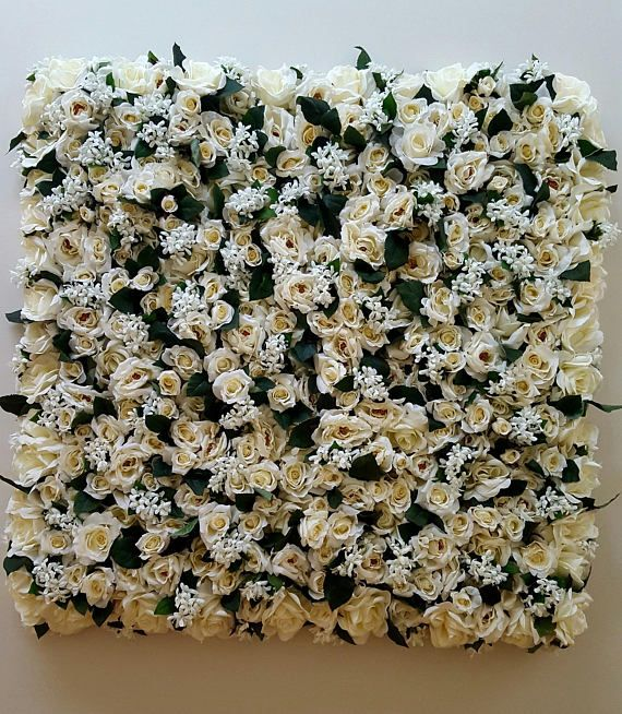 Ivory Dreams is 900mm x 900mm and filled with Roses and Stephanotis with over 700 flowers   Perfect for behind a Cake Table, Registery Table, Bridal Table and more  This is on a frame and can be hung as a roof chandelier piece   These are all hand made with quality faux flowers   I have been a florist for 35 years and love my job.  I have sold Bouquets, wedding arrangements and floral designs to the most remote parts of Australia, especially where fresh flowers are not available, and for…