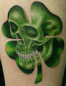 Skull four leaf clover tattoo