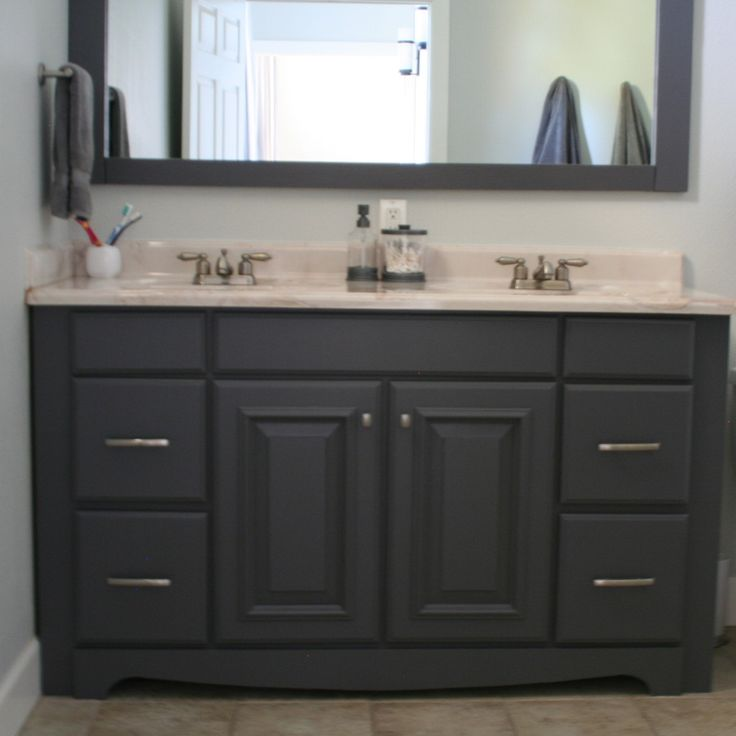 Gray Painted Bathroom Vanity And Framed Mirror