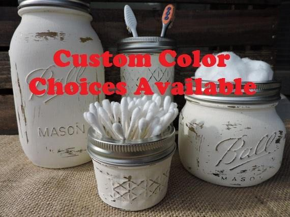 Custom mason jar bathroom set includes 4 Ball Canning jars: 1-Quart (32 oz) sized soap dispenser, 1-12 oz quilted crystal jelly jar (toothbrush holder), 1-wide mouth pint sized jar (cotton ball holder) and a 4 oz quilted crystal jelly jar (q-tip holder). The mason jars are painted with