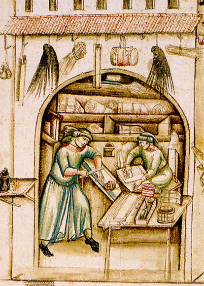 A parchment-seller's shop, illustrated in a fifteenth-century Italian chronicle. One man is trimming the sheets into rectangles and the other is rubbing them down with chalk in preparation for writing. The stock for sale on the shelves includes both rolls and packets of ready-folded sheets
