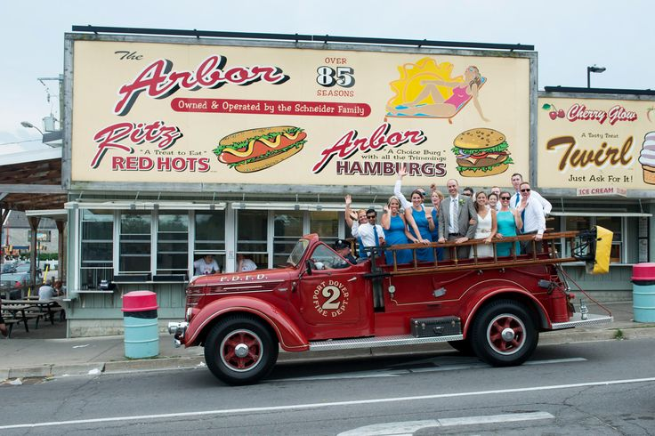 Port Dover Arbor Dogs - Wedding Photography - Old fire truck driving the wedding party around Port Dover and the iconic Arbor in the heart of the town.  Super fun shoot following the fire truck, everyone was waving and having a good time!