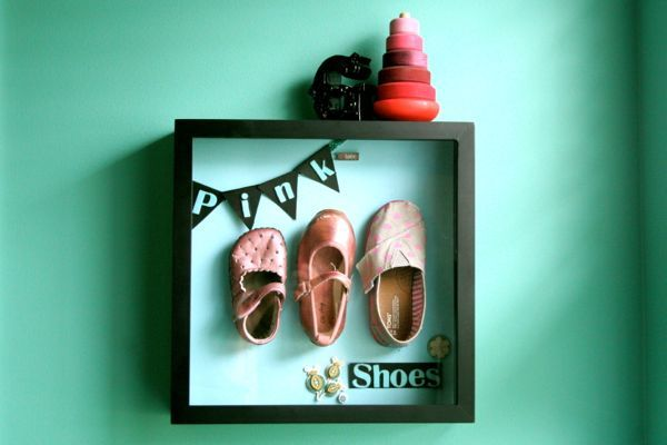 I could make this masculine - would be so sweet.  I know my mom saved some of our shoes from childhood - this would be a sweet way to display C's shoes from the first pair he wears to his favorite ones as a little kid.  -k