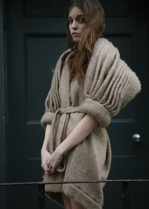 This dress sweater looks rugged & firm & wooly. It looks really heavy & it makes the body appear larger.