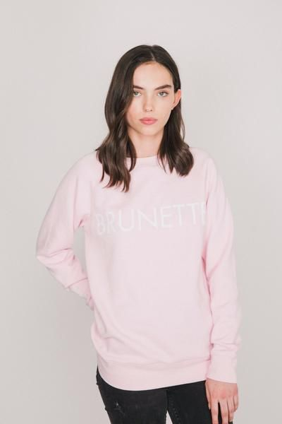 Our BRUNETTE crew neck sweater is now available in pretty pink with white font. We fit cozy. Fibre Content: 52% Polyester 48% Cotton,modeled in size S/M. -Designedin Canada