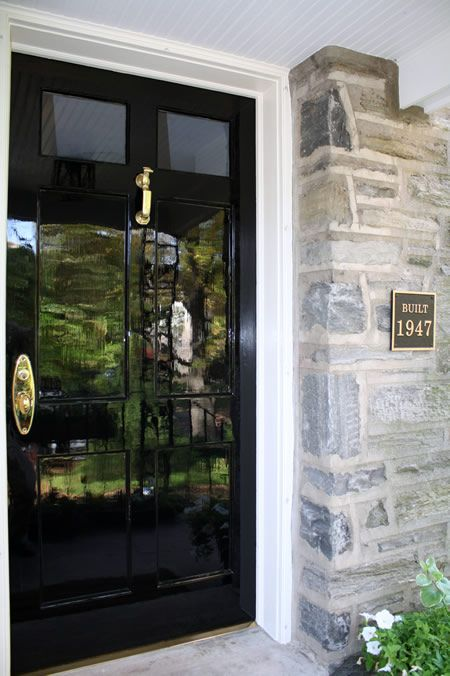Hollandlac Brilliant for front doors. This marine grade paint is so glossy it is reflective like a mirror. It comes in a zillion colors, but in black it would look like black patent leather! My favorite colors are in their Classic Euoropean Collection