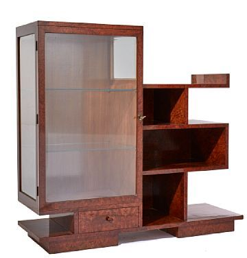 SHELF WITH GLASS CASE  Walnut. Art Deco. The start of the 1900s.  Left side with cabinets, walls and shelves in glass. Lower section with drawer. Right side with shelves. Lock and key.