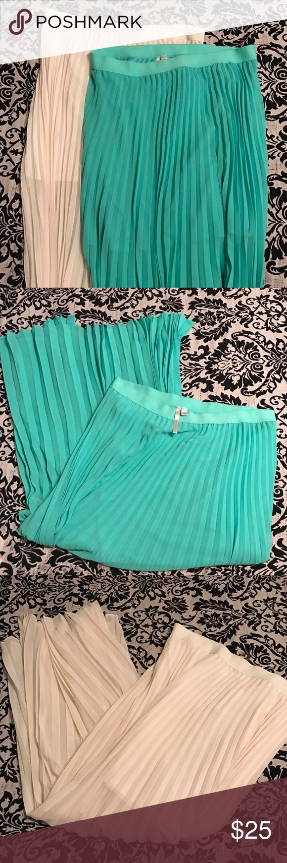 Mint green and ivory Lauren Conrad maxi skirt. XL Lauren Conrad maxi skirts. 2 maxi skirts colors mint and ivory. Worn once. Excellent condition. Each skirt about 41 1/2 inches long. LC Lauren Conrad Skirts Maxi