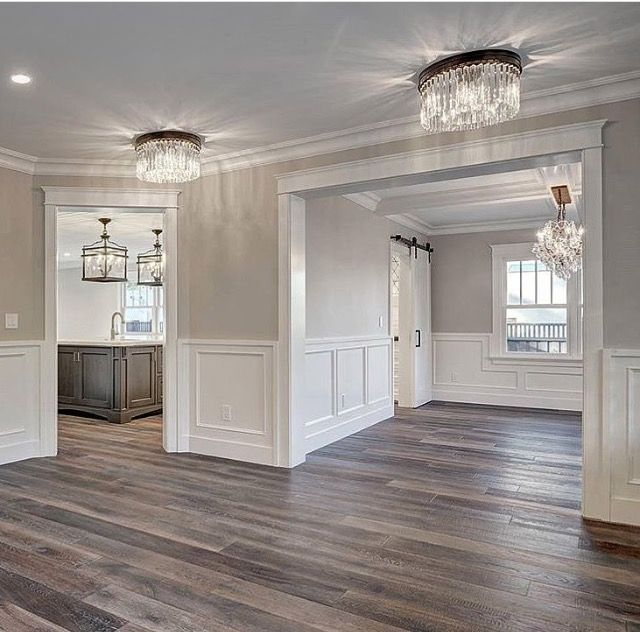 Love the floors, chandeliers and wainscoting