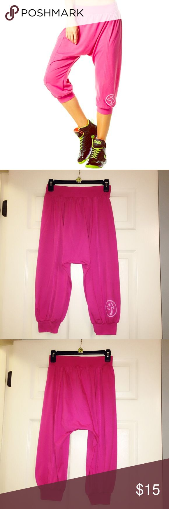 Zumba™ Pink Harem Capri Pants - Size X-Small 💃🏻 Check out these comfy Zumba™ Hang Loose Harem Capri Pant. These pants give a slouchy, but sassy silhouette that provides you room to groove, while the elastic waistband keeps your pants in place as you shuffle across the floor. They are size X-Small. Material: 65% Polyester, 35% Cotton. Zumba™ Pants Capris