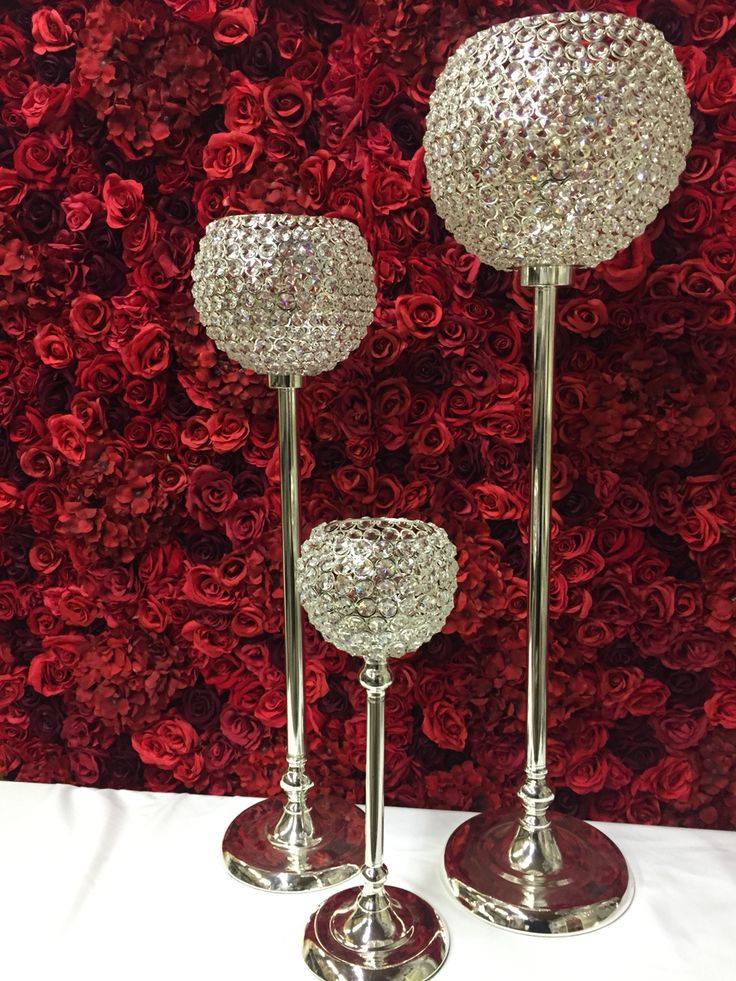 Red #flowerwall with crystal table centres