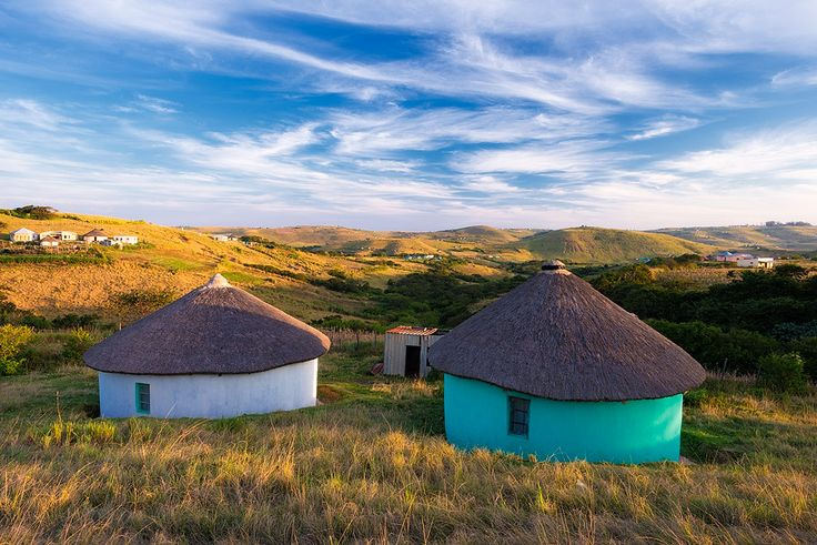 Landscape photo of two xhosa huts in the hills of South Africa's wild coast