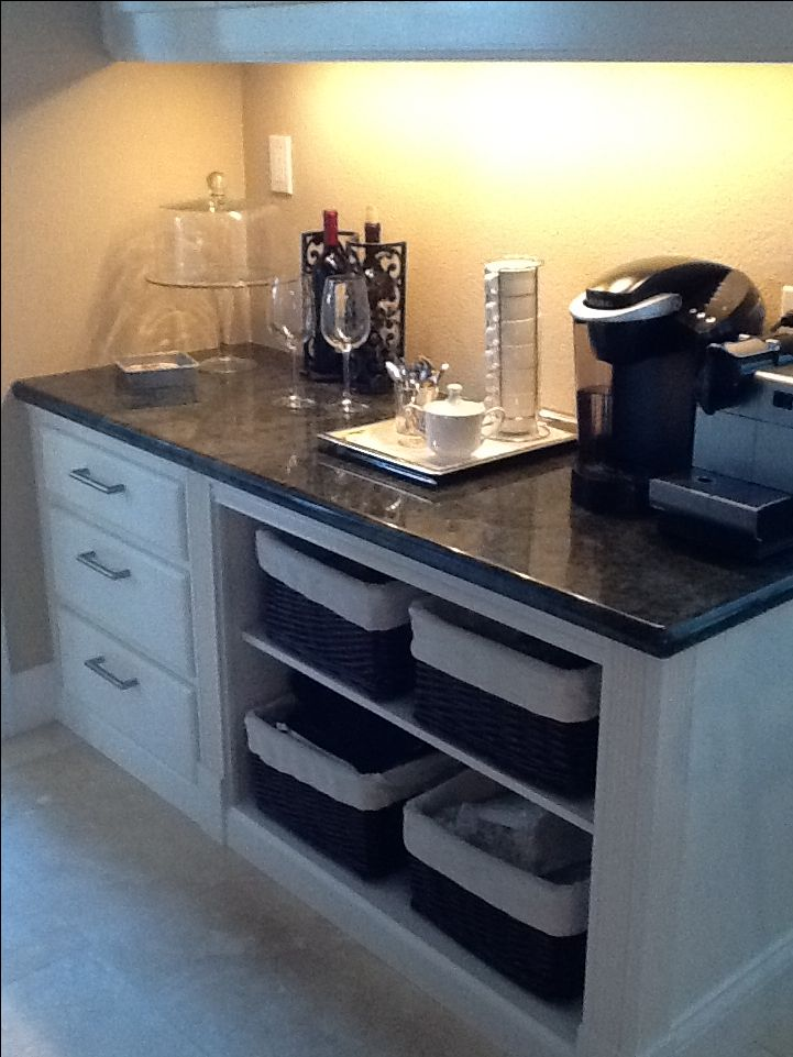 A coffee bar replaces a built in desk in our kitchen