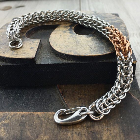 Theres nothing quite like the feel of a hefty steel chain, and this bracelet has all that plus a gorgeous bronze stripe. This full persian bracelet is perfect for both men and women. This bracelet is finished with an easy to use stainless steel spring clasp. This chain comes in several sizes that are ready to ship and is 5/8 inch wide. It is made of well over 100 individually placed 18 gauge stainless steel and bronze rings. The spring clasp is also stainless steel. All my rings are saw...