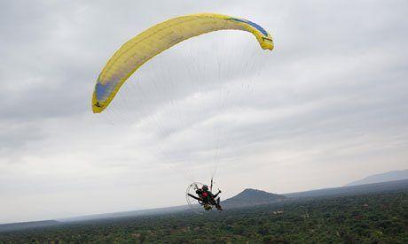 Martin Wheeler, aka 'bird-man', and team use paraglider, car and footwork in surveillance effort to help thwart illegal wildlife trade