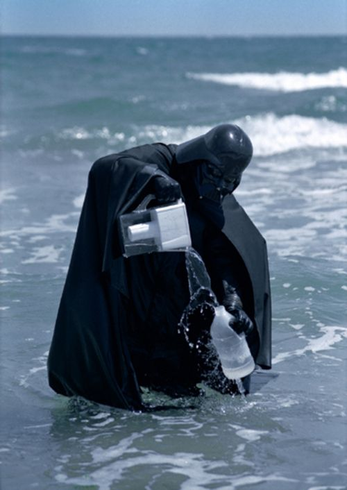 """Daniel Bozhkov, """"Darth Vader Tries to Clean the Black Sea With Brita Filter"""", 2000 (C-print mounted on aluminum, Ed. of 5)"""