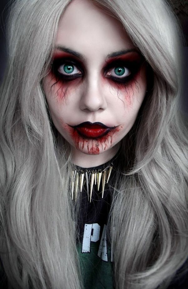 Vampire inspired Halloween makeup. Vampires will never be forgotten on Halloween and this is the perfect look that you can go for with your vampire costume. The color combination of black and red blushes makes a good resemblance to blood and veins running through the body in a creepy way.